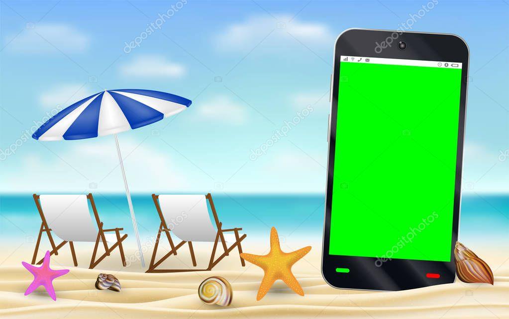 smartphone green screen on sea sand beach