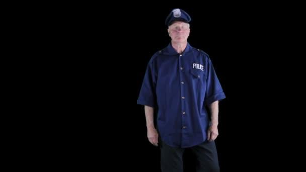 Muž, oblečený jako stráž nebo policista chůzi jistotu beat