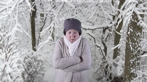 Woman sneezing, winter forest