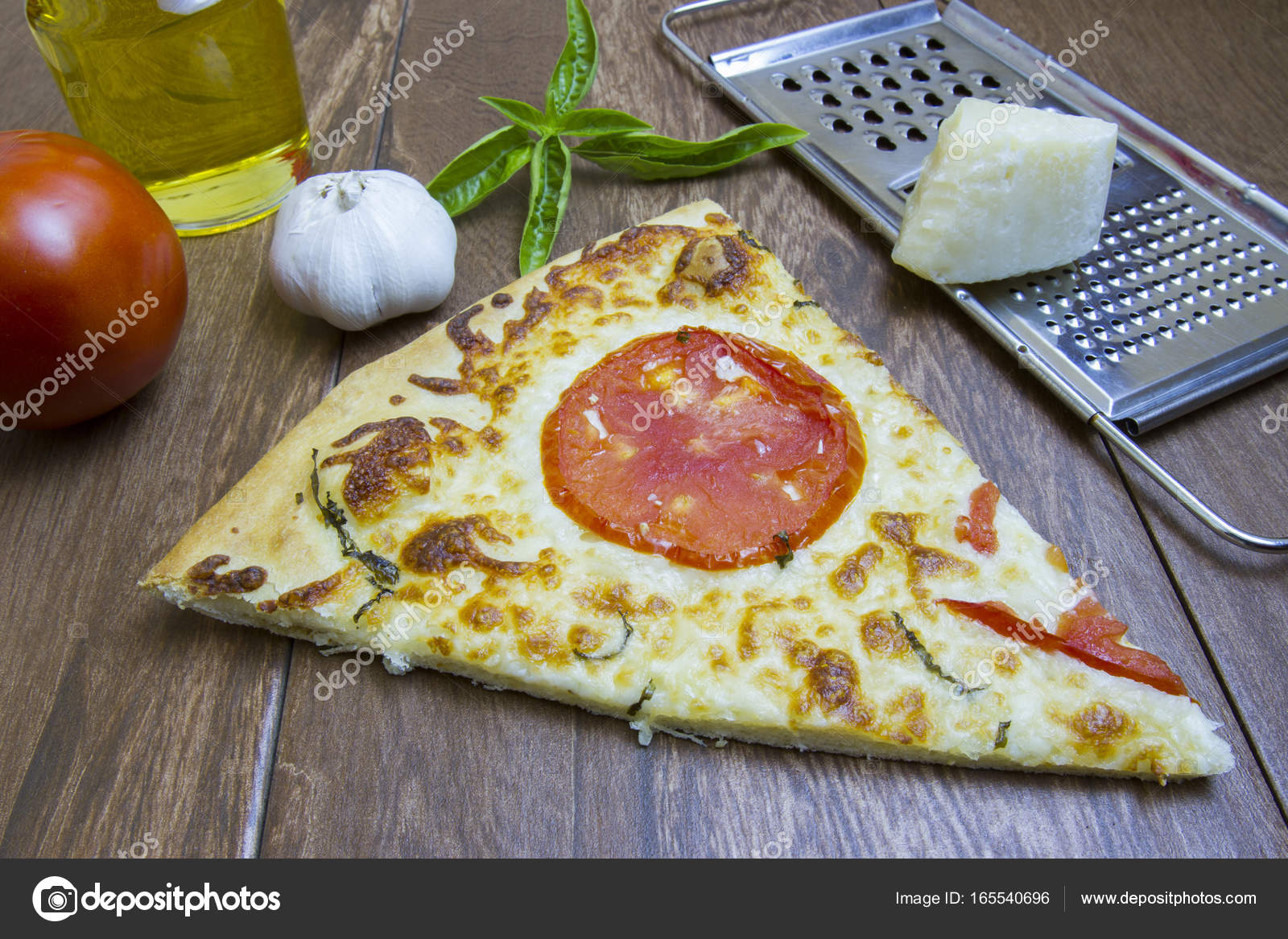 Fresh Basil Whole Ripe Tomato Olive Oil And Cheese With Baked Margarita Pizza Slice On Kitchen Tile Photo By Karenfoleyphotography