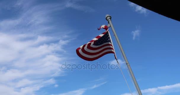 American flag against blue skies