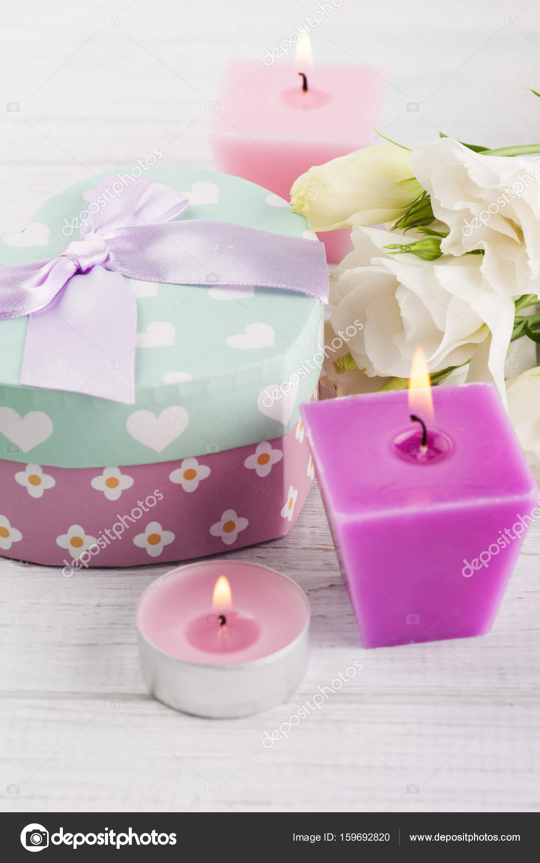 Arrangement of candles, flowers, pastel gift box — Stock Photo ...
