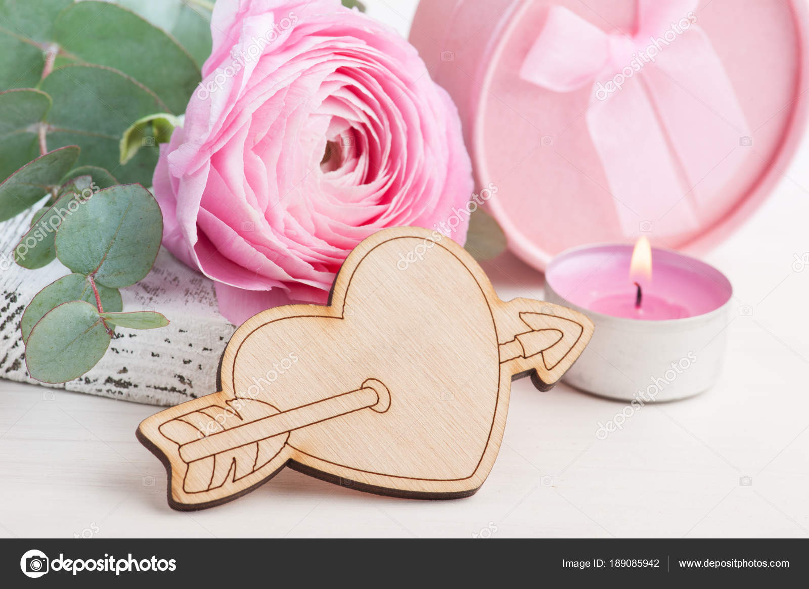 Pink buttercup flower with wooden heart — Stock Photo © irinabort ...