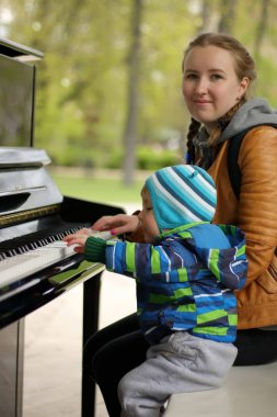 Mother and child play music in the park