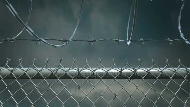 Camera fly over the barbed wire fence. Radioactive warning sign.