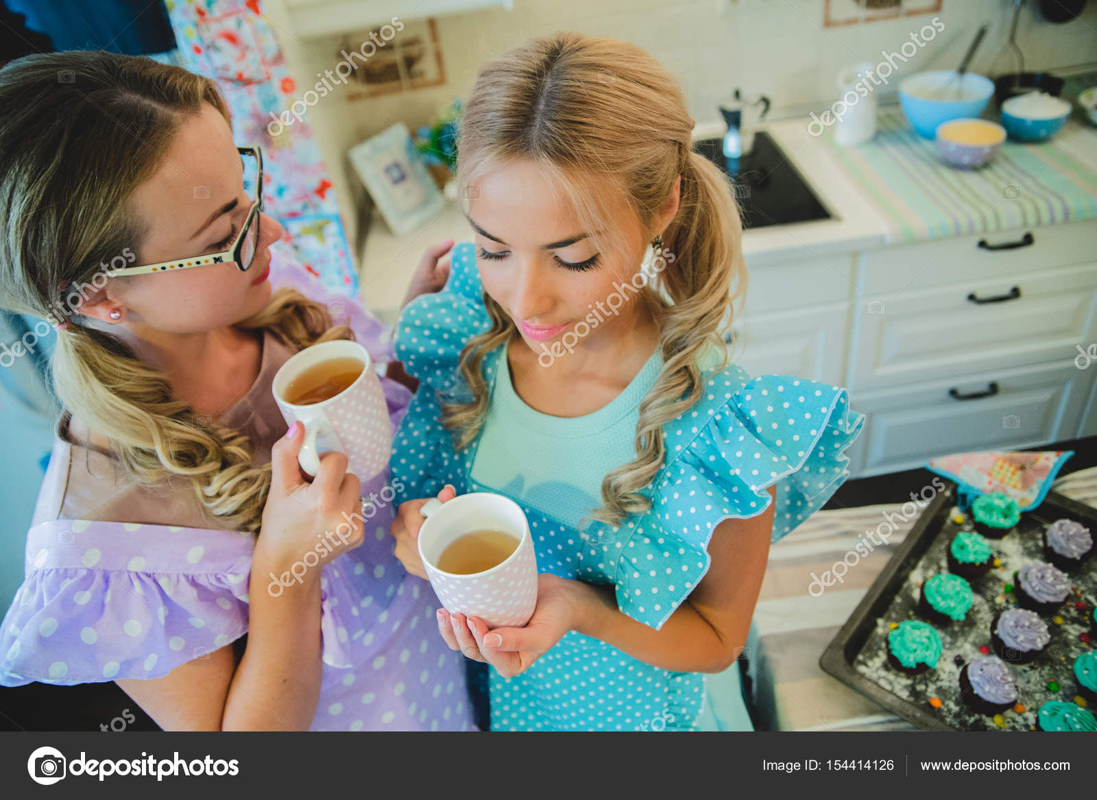 two women in kitchen drinking a cup of tea — Stock Photo © Bajneva ...