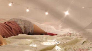 A young woman in a Christmas interior asleep, a home festive interior