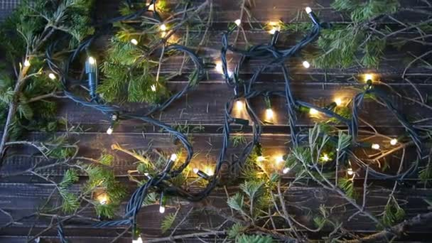 Christmas garland and spruce branches on a wooden table