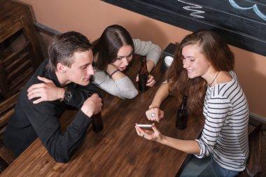 Surprised people meeting in a coffee shop