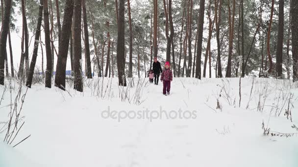 Family walking on a snowy forest