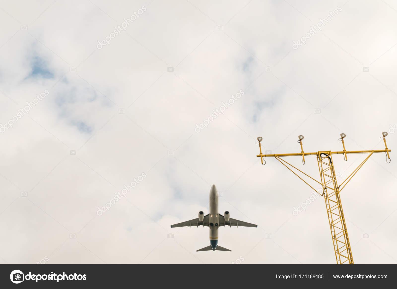 Airplane above the landing lights — Stock Photo © GrashAlex #174188480