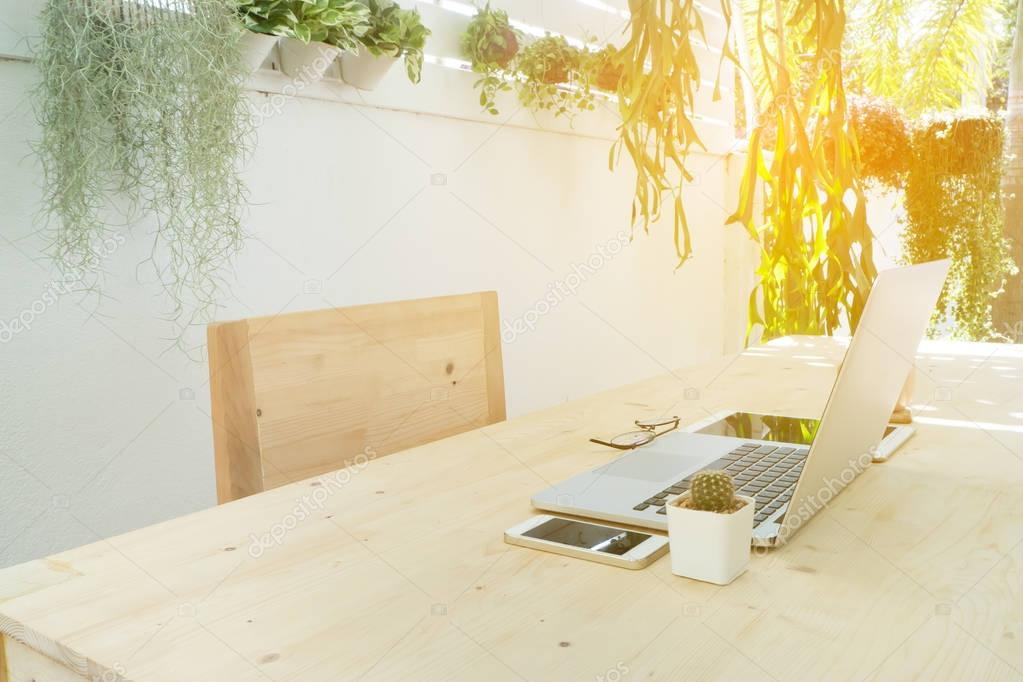 Office wood table and chair in the garden, natural work place at