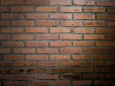 vintage brick wall texture background for text with spot light e