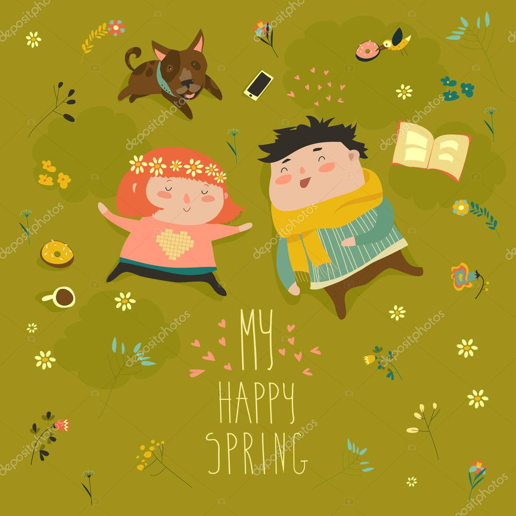 Happy kids lying on the meadow grass full of spring flowers