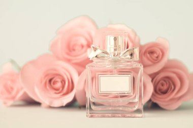 Vintage perfume bottle and pink roses stock vector