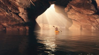 Kayaker  floating to the cave