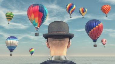 Man looking at an hot air balloons