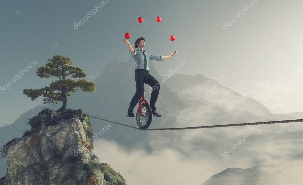 Juggler is balancing on rope