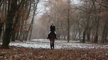 Pretty woman posing on horse