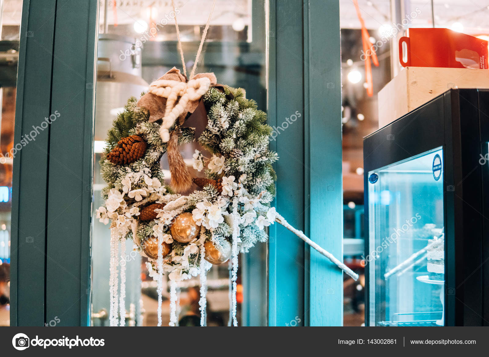 Christmas Wreath Hanging On The Glass Door Stock Photo Simbiothy
