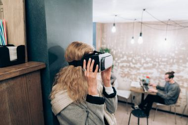 Young girl getting experience VR headset