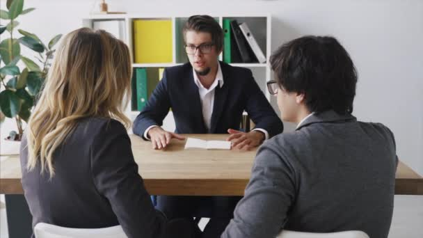 Businessman Talking with Employees at the Table