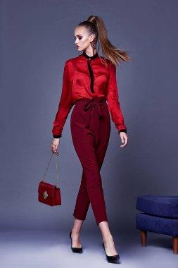 Beautiful sexy pretty woman wear red silk blouse and pants skinn