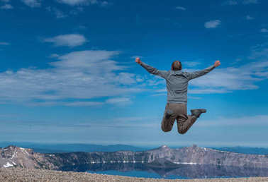 Man Leaps at Overlook to Crater Lake