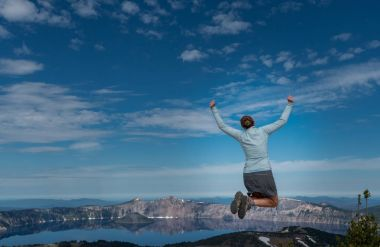 Woman Leaps at Overlook to Crater Lake