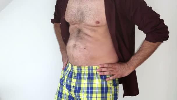 closeup of fat man doing a little bellydance