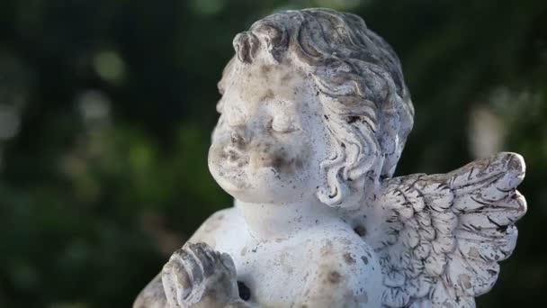 praying stone angel on rotating plate