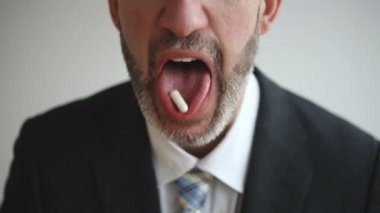 Cinemagraph of close-up of man with pill in his mouth