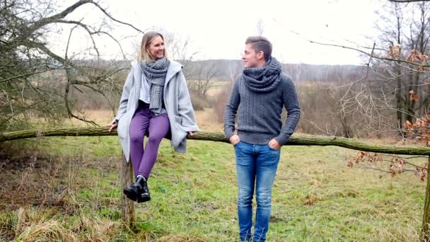 Cinemagraph of young couple on the countryside by a wooden fence