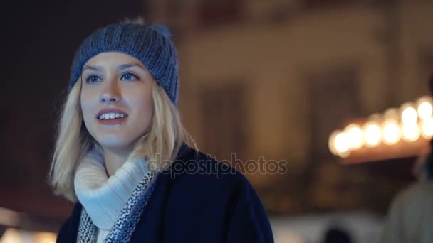 Young girl waiting for his boyfriend at christmas market.