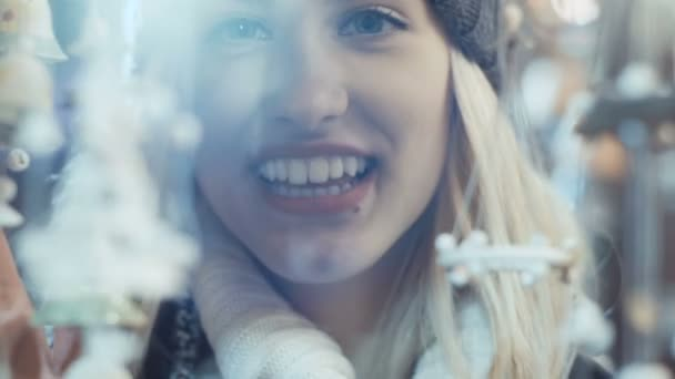 Young smiling woman at christmas market in a city.