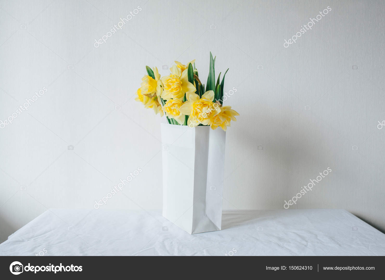 Bouquet of narcissus in a paper bag. Flower delivery. Spring yellow ...