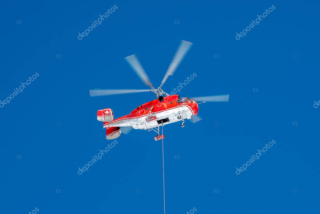 Red rescue helicopter with basket