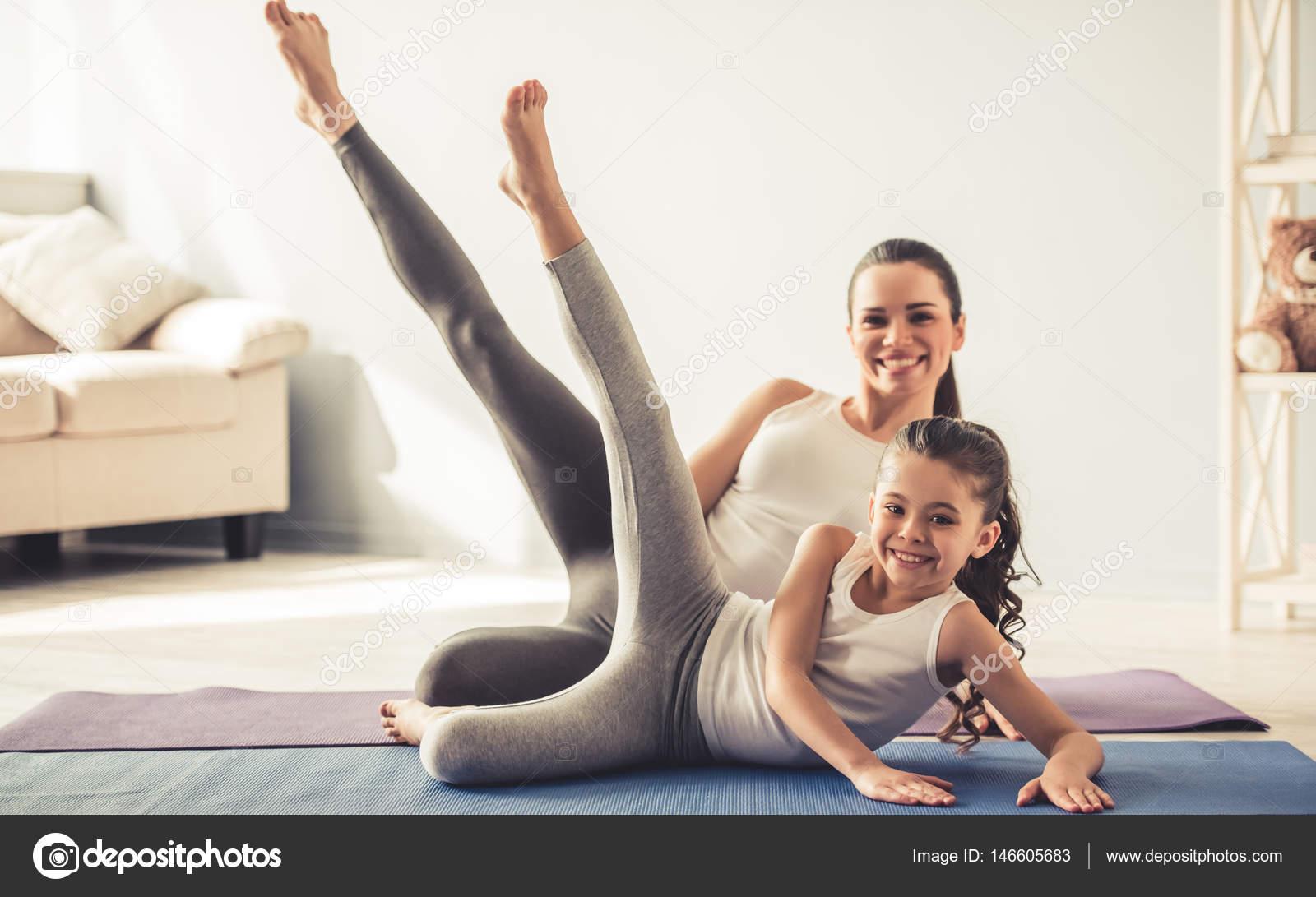 Mom and daughter doing yoga — Stock Photo © vadimphoto1 ...