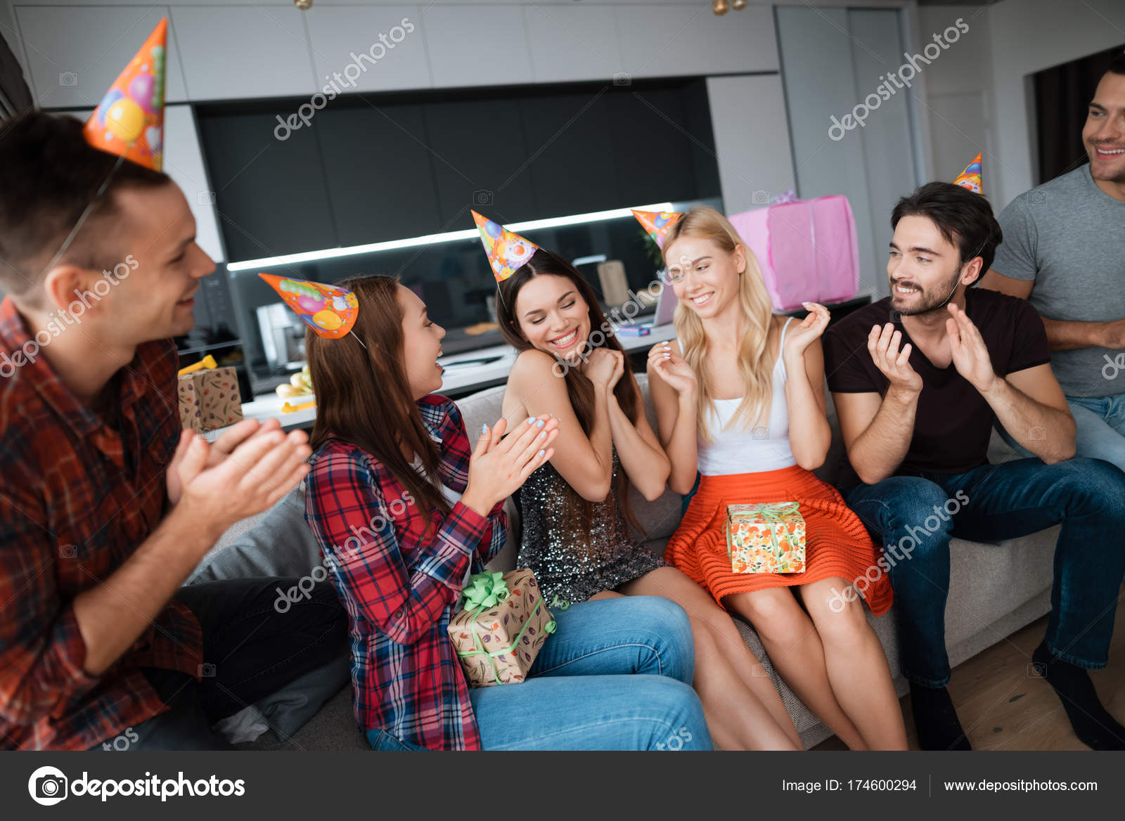 party in honor of the birthday guests give their gifts to the