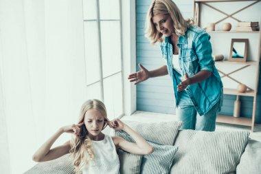 Blonde adult mother brings up naughty girl teenager.