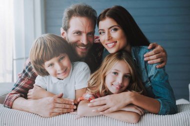 Portrait of happy parents with lovely children. Full healthy families concept.