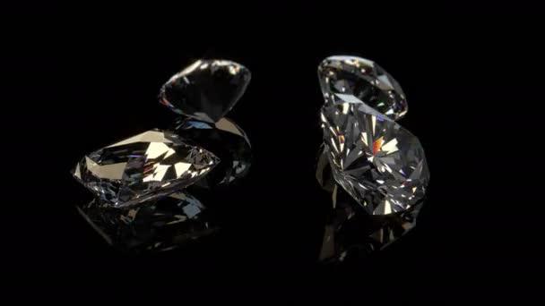 négy gyémánt forog a fekete háttér