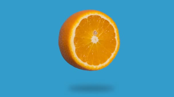 stop motion animation of fresh orange juice disappears, appears on a blue background