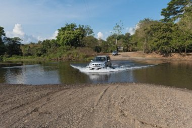 Car at a river crossing near Drake, Costa Rica