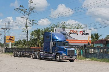 Blue truck on Highway 32 at Puerto Limon, Costa Rica