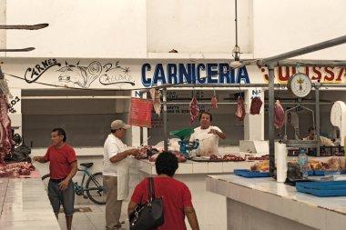 CHETUMAL, MEXICO-MARCH 09, 2018: Butcher in the Mercado Ignacio Manuel Altamirano, Chetumal, Mexico