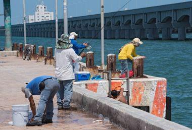 PROGRESO, MEXICO-MARCH 17, 2018: Fisherman on the Fishermans Wharf in Progreso (Muelle De Pescadores), Yucatan, Mexico