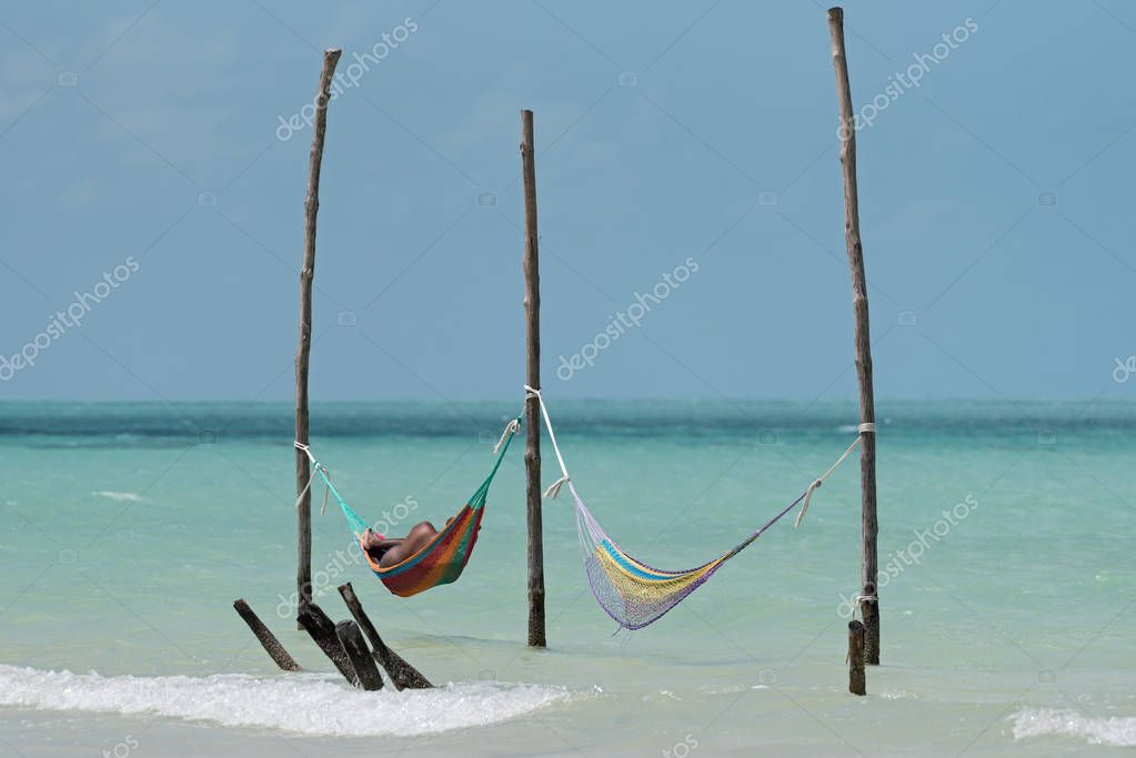 Two hammocks on the beach of Holbox, Mexico