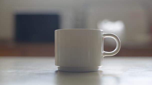 Close up smoking on coffee cup.