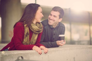 Mixed race couple embracing, smiling and enjoying